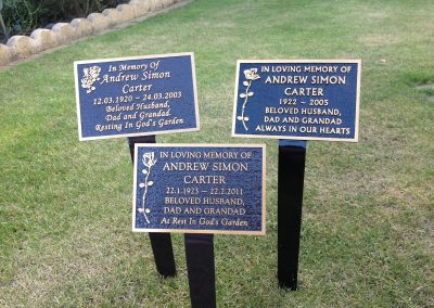 Three square marker plaques