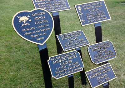 A set of memorial plaques in grass