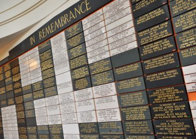 A wall of plaques with memorials to loved ones.